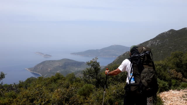 Backpacker is watching the mediterranean sea video