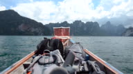 backpacker on boat in Cheow Lan lake, Thailand video