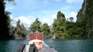 backpacker on boat in landmark of Cheow Lan lake, Thailand video