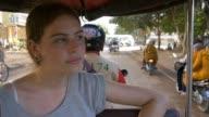 Backpacker tourist girl traveling in asia riding on tuk tuk rural asain villag video