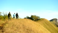 backpackers walk, walk and walk on the edge of mountain video