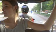 Backpacking young tourist girl traveling in tuk tuk in asia Cambodia video