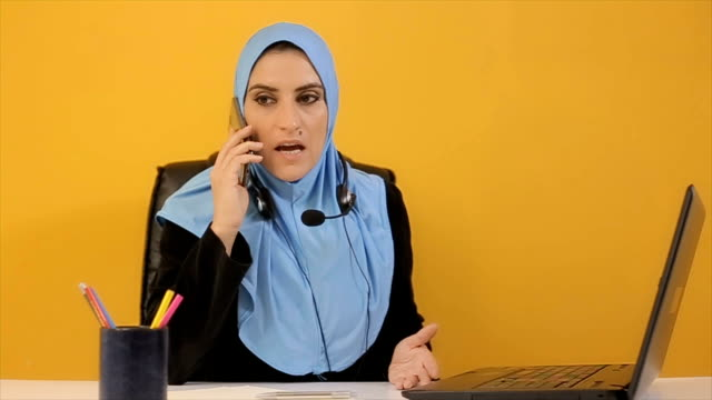 Bad business news,Arab businesswoman talking on mobile phone video