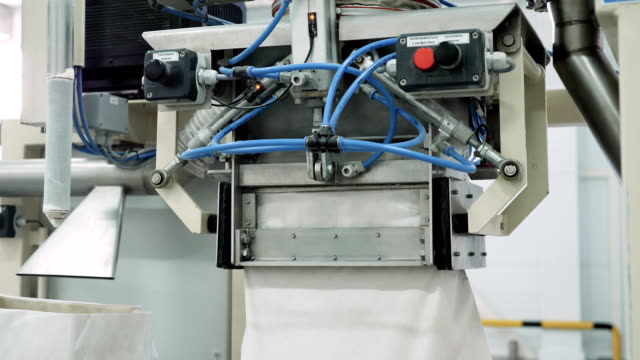 Bag filling machine in the factory video