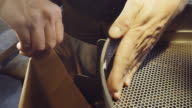 Bagging Beans at Coffee Roastery video