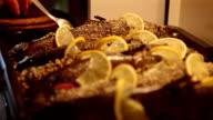 Baked salmon with lemon in baking sheet video