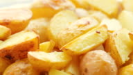 baked sliced potato, closeup video