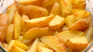 baked sliced potatoes on the plate video