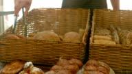 Baker arranging bread in baskets video