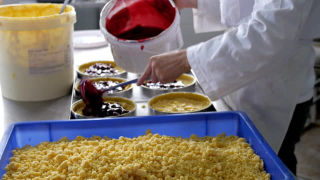 Baker filling prepared bases with berry mixture video