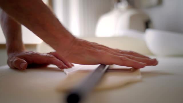 Baker hands rolling the dough video