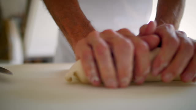 Baker hands stretching the dough video