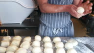 Baker making handmade loaves of bread video