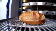 Baker moving bread using shovel-baker video