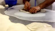 Baker prepares traditional Burek (Börek) or Phyllo Meat Pie video
