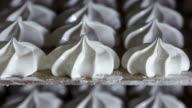 Bakery cooling racks with finished marshmallow zephyr at confectionery factory video