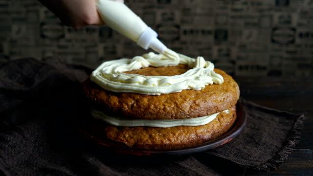 Baking cake. Closeup of cake decoration. Chef decorating cake with cream video