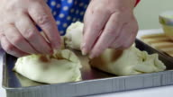 Baking pies of puff pastry on  tray video