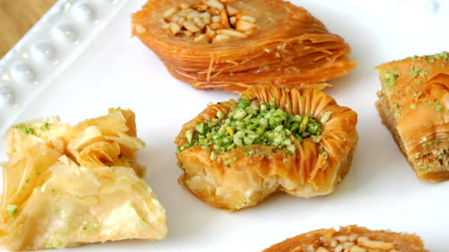 Baklava sweet assortment: pastrie covered with pistachio and nuts video