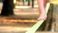Balancing barefoot on a slackline video