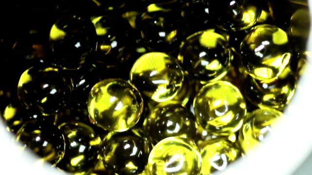 Balls of Fish Oil in Can video