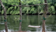 Bamboo swing near the river video