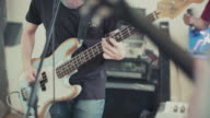 Band playing in their rehearsal studio: the bass guitar video
