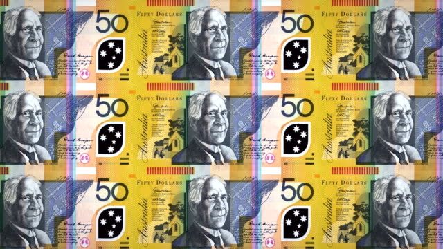 Banknotes of fifty australian dollars rolling on screen, cash money, loop video