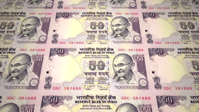 Banknotes of fifty indian rupees of India rolling, cash money, loop video