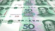 Banknotes of fifty renminbi chinese rolling on screen, cash money, loop video