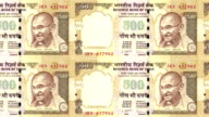 Banknotes of five hundred indian rupees of the bank of the Republic of India rolling on screen, coins of the world, cash money, loop video