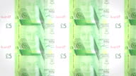 Banknotes of five pounds sterling of Gibraltar rolling, cash money, loop video
