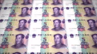 Banknotes of five renminbi chinese rolling on screen, cash money, loop video
