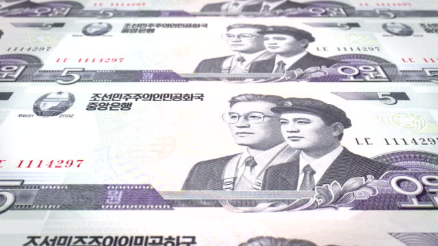 Banknotes of five wons of North Korea rolling, cash money, loop video