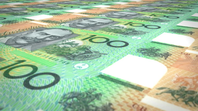 Banknotes of one hundred australian dollars rolling on screen, cash money, loop video