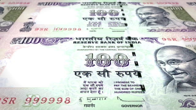Banknotes of one hundred indian rupees of India rolling, cash money, loop video