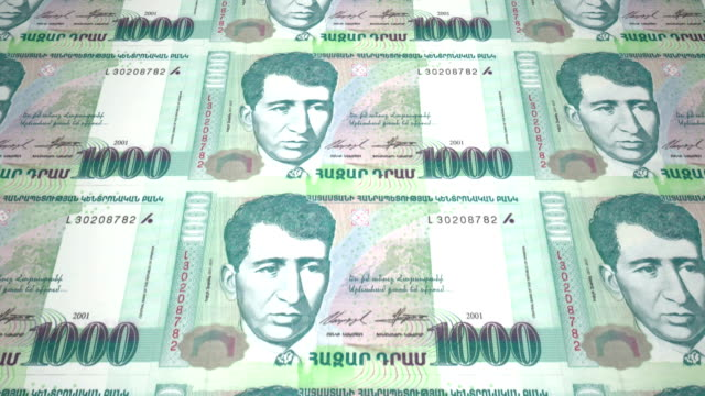 Banknotes of one thousand armenian drams of Armenia rolling, cash money video
