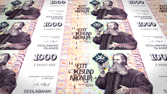 Banknotes of one thousand kroner or crowns of Iceland rolling, cash money video