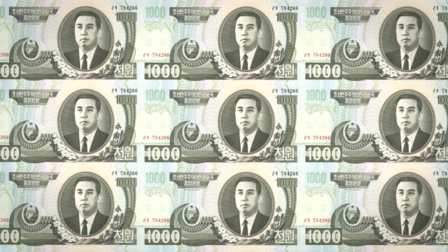 Banknotes of one thousand wons of North Korea rolling, cash money, loop video