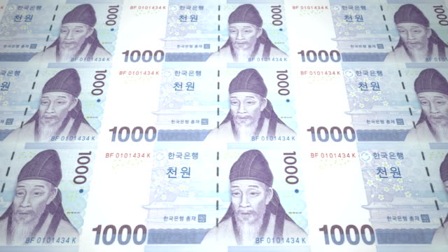 Banknotes of one thousand wons of South Korea rolling, cash money, loop video