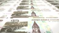 Banknotes of ten rubles russians rolling on screen, cash money, loop video