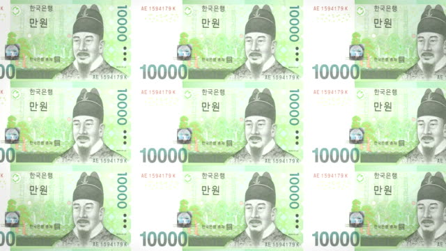 Banknotes of ten thousand wons of South Korean rolling, cash money, loop video