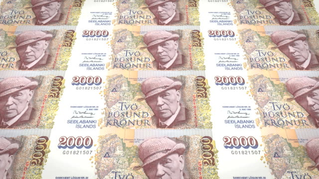 Banknotes of two thousand kroner or crowns of iceland rolling, cash money video