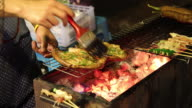 Barbecue at night market in Thailand video