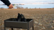 Barbecue stands on the shore of the lake. video
