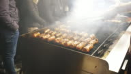 Barbecue with meat rolls. video
