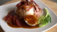 Barbecued red pork in sauce with rice video
