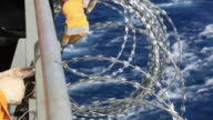 barbed wire at sea video