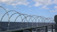 Barbed wire for ship protection video