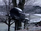 Barbeque Grill covered in icicles video